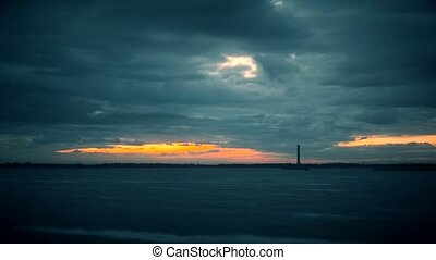 Timelapse with lighthouse during daybreak with colorful...