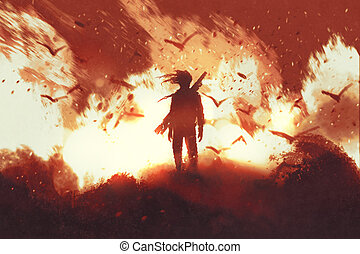man stands against fire background - man with gun standing...