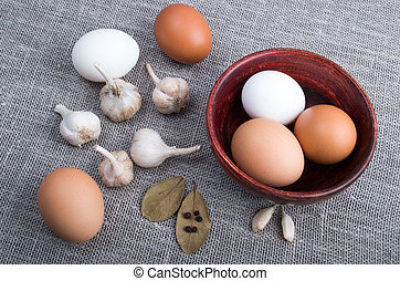 Top view of a chicken egg and garlic and spices on the...