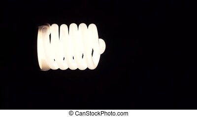 light bulb glowing in dark