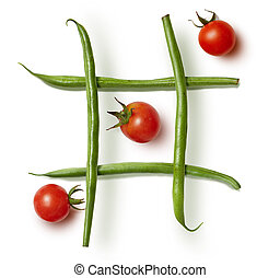 Food game Tic-tac-toe. diet beans and cherry tomatoes on a...