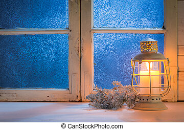 Frosted window with candle for Christmas