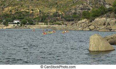 kayaking - group of people kayaking on a lake