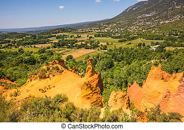 Reserve for ocher mining - Orange and red picturesque hills....