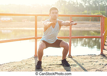 Fit man working out glutes with bodyweight workout doing...