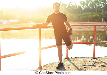 Fit young man preparation for running workout Jogger...