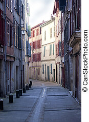 Street on the morning - Facades of old house in a street of...