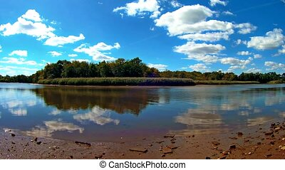 Summit lake wide shot - Calm day at a lake. Sky, trees and...