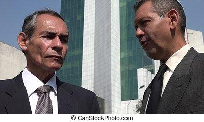 Older Business Men Listening Or Talking