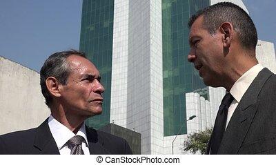 Older Business Men Talking