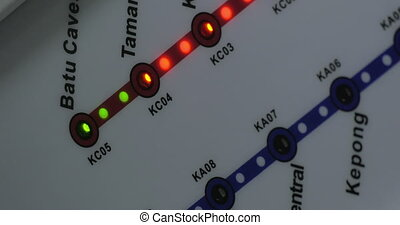 Close up view of lighting green and red bulbs on train map. Kuala Lumpur, Malaysia