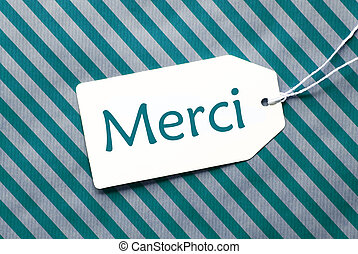 Label On Turquoise Wrapping Paper, Merci Means Thank You -...