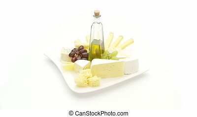 cheeseplate with olive oi - variation of cheese with grapes...