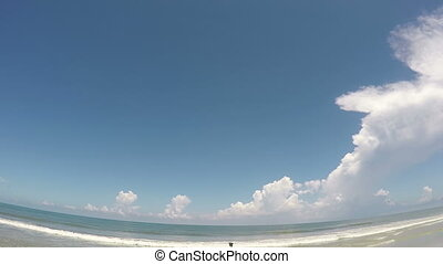 Fish eye time lapse beach - Time lapse fish eye view of...