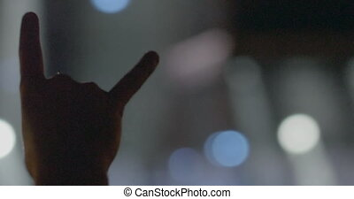 Horn fingers at rock concert - Hand of rock fan showing...