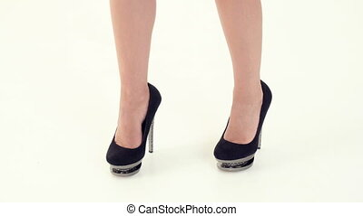 female legs on high heels dancing - beautiful female legs on...