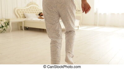 woman run jump on bed man hug her couple home bedroom