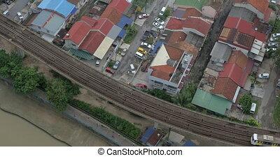 Train moving on overground railway in Kuala Lumpur, Malaysia...
