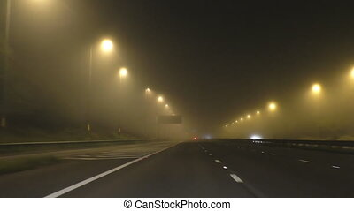Driving on foggy motorway at night - Driver's point of view...