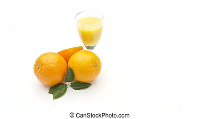 orange juice - fresh orange juice in glass with oranges on...
