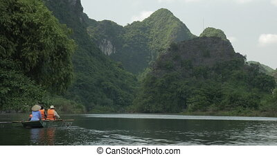 Excursion in Trang an bai, boat cave tours. Hanoi, Vietnam -...