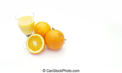 fruit juice - oranges and glass of orange juice on white