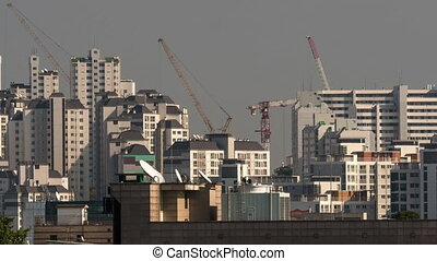 Timelapse of building cranes working in Seoul, South Korea -...