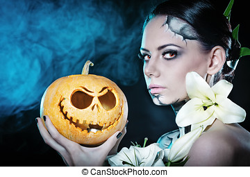 Girl with makeup for Halloween Pumpkin - Young attractive...