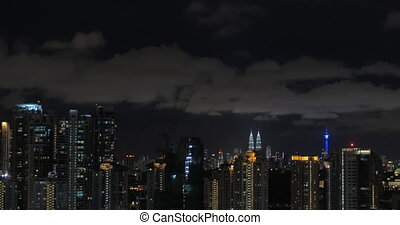 In Kuala Lumpur, Malaysia seen night city with Petronas twin towers and skyscrapers