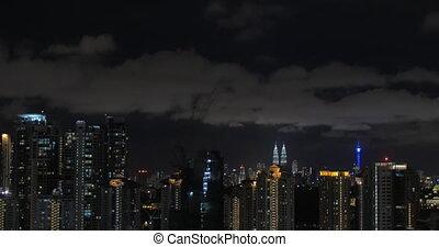 In Kuala Lumpur, Malaysia seen night city with Petronas twin...