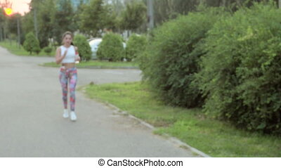 woman running in Park - beautiful sporty woman running in...
