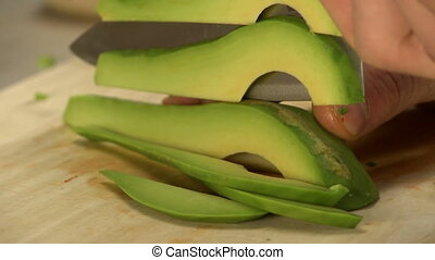 View of chef slicing avocado, close-up - View of...