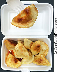 Chinese dumpling takeaway - Close up of Chines dumpling on a...