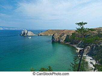 Rock Shamanka at headland Burhan Olkhon island, lake Baikal,...