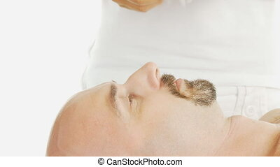 acupuncture head - placing acupuncture needle on mans head