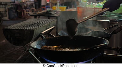 Cooking in street restaurant of Bangkok, Thailand
