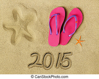 2015 text on sand and beach accessories