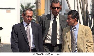 Older Hispanic Business Men Walking