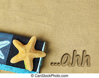 Relaxation concept on the beach - Ahh... text on sand and...