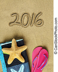 2016 text on sand and beach accessories