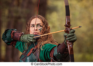 Aiming Elf woman in green leather armor with the bow and...