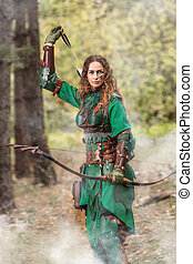 Elf woman in green leather armor with the bow and arrows is...