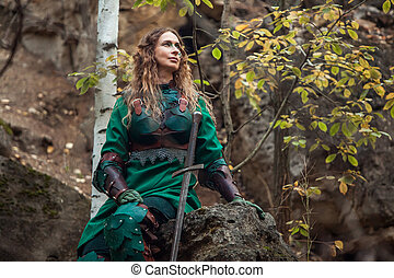 Elf woman in green leather armor with the sword is sitting...