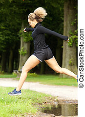 sporty woman jumping