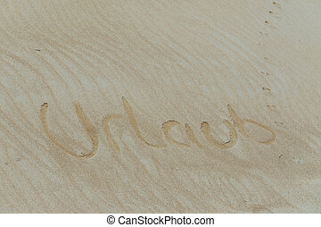 Sand word in German holiday. - Golden sand with a subscribed...