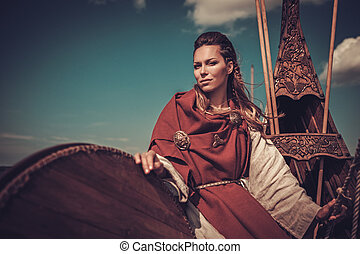 Viking woman with shield on Drakkar - Confident viking woman...
