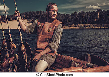Confident viking man on Drakkar - Confident viking man on...