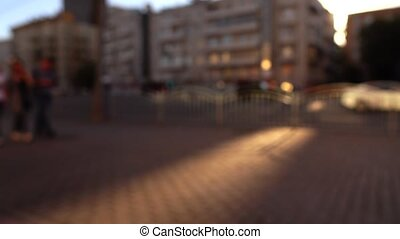 Defocused urban street in the evening Cars and walking...
