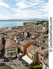 View of colorful old buildings in Sirmione and Lake Garda...
