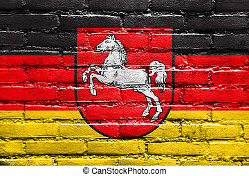 Flag of Lower Saxony, Germany, painted on brick wall